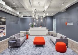 Grey and fire orange themed reception and seating area at the non-profit Cardiovascular Research Foundation headquarters built by J.T. Magen in Midtown Manhattan.
