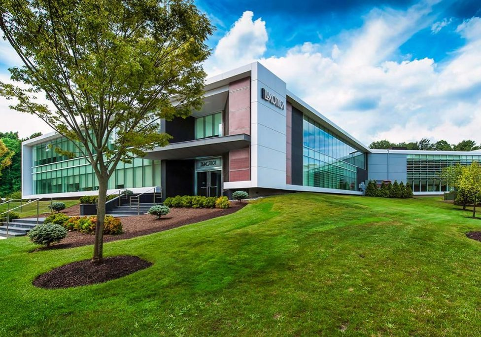 Exterior view of the gardens and renovated façade of Luxottica eyewear headquarters built by general contractor J.T. Magen & Company Inc. on Harbor Park Drive in Port Washington, New York.