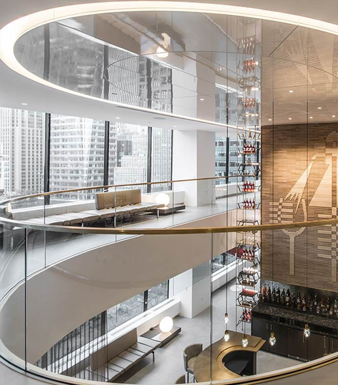 An interior post-construction image of the atrium bar in the Campari Group headquarters in the Grace Building, New York built by J.T. Magen.