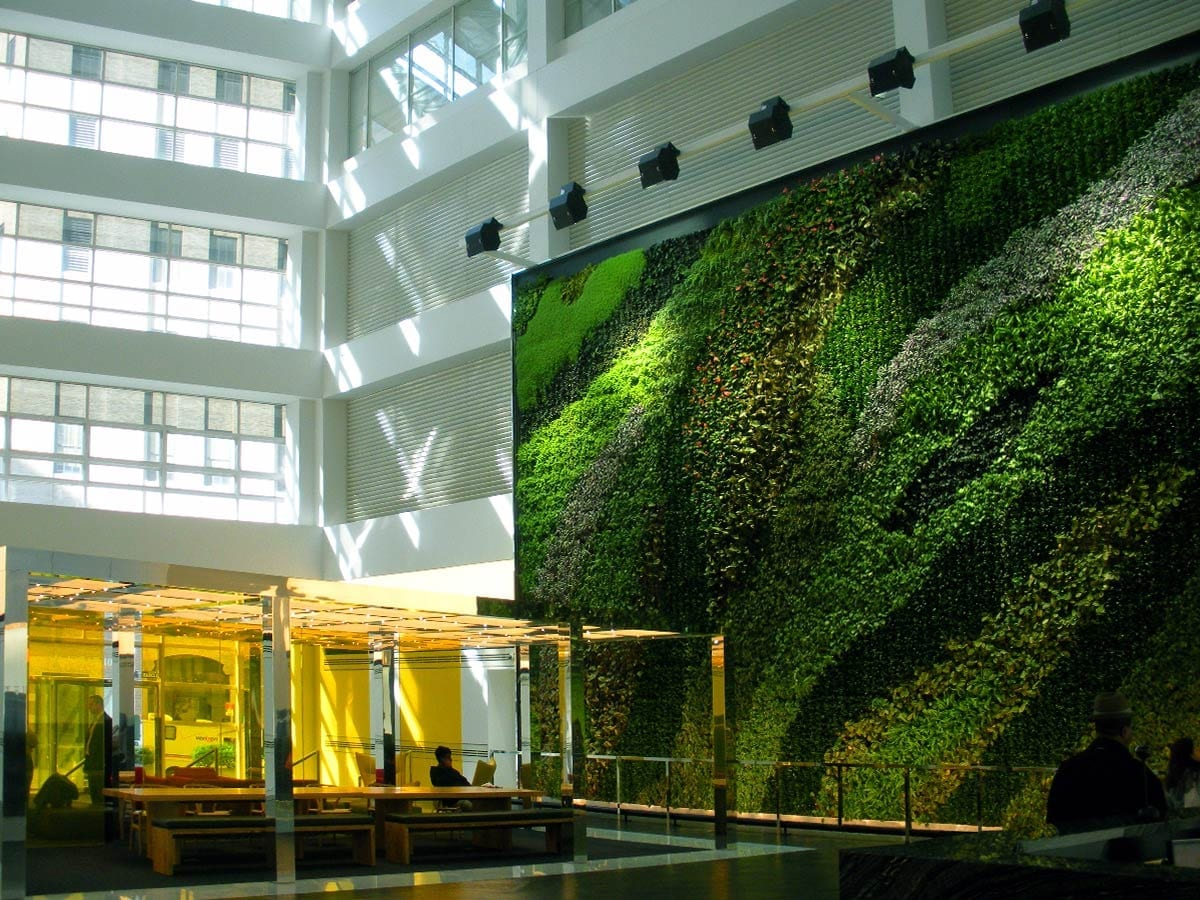After: Atrium lobby and green living life completed by general contractor J.T. Magen & Company Inc. for a client in the global financial services sector in New York.