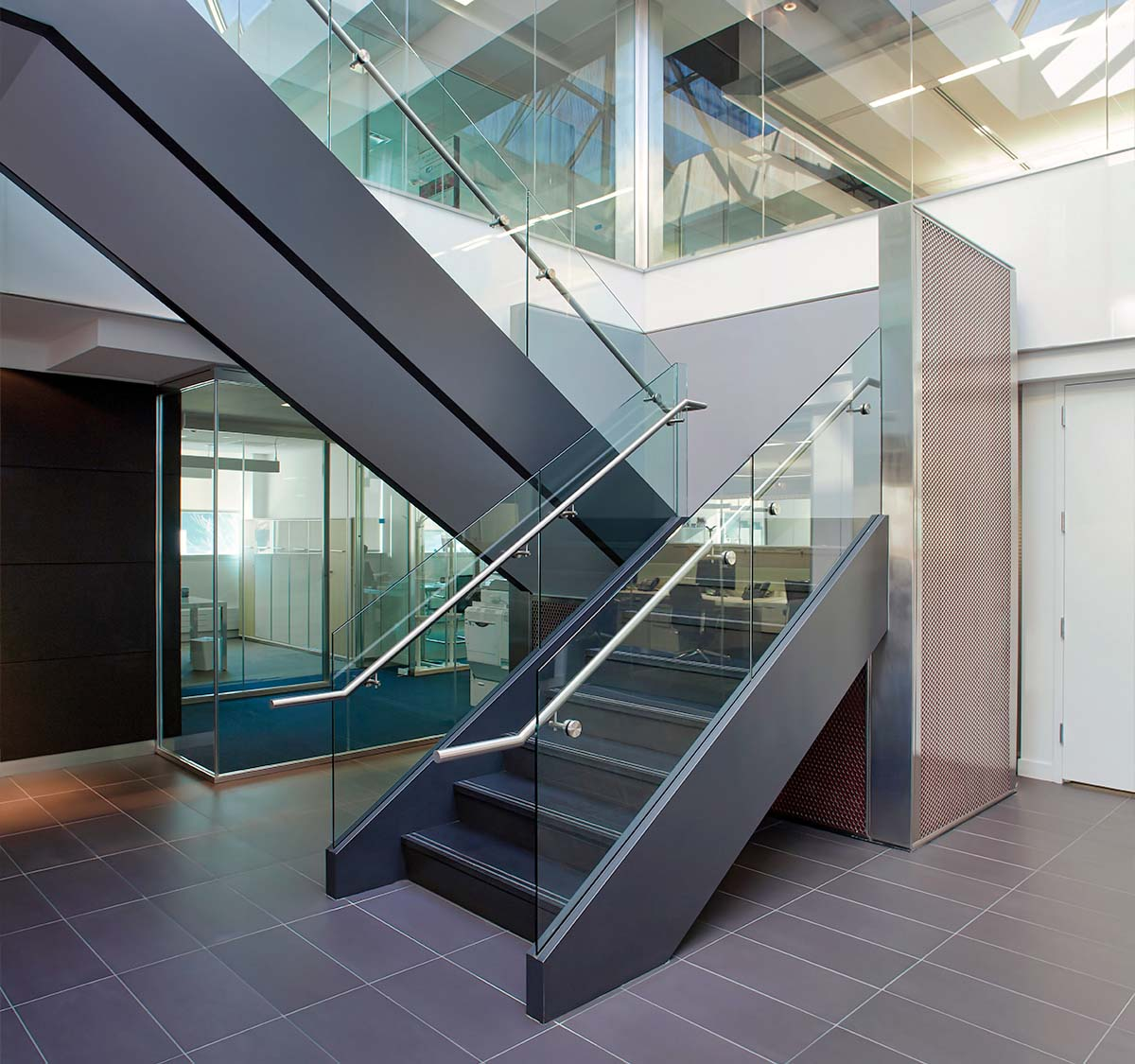 After: The staircase post-construction at Luxottica eyewear's Long Island headquarters built on Harbor Park Drive in Port Washington, New York by J.T. Magen & Company Inc.