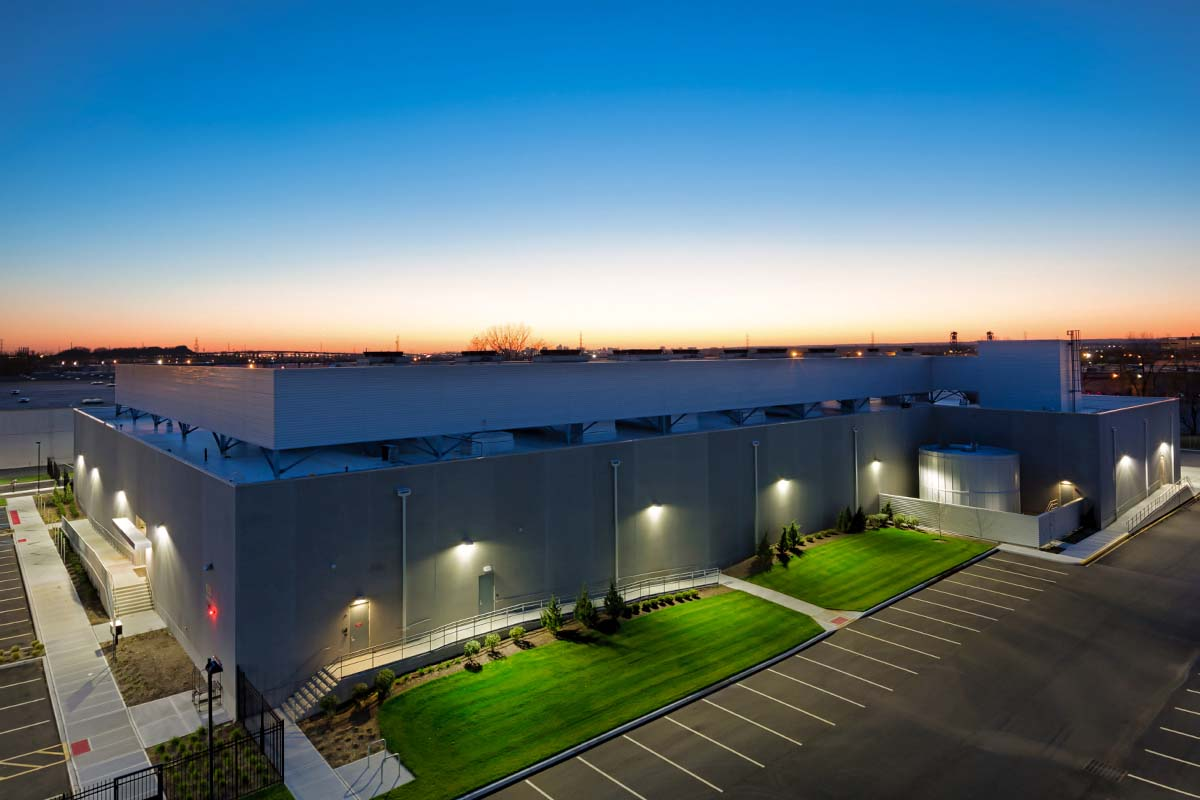 After: Exterior nighttime view of the of completed construction of the NY6 data center built by general contractor J.T. Magen & Company Inc. in Secaucus, New Jersey.