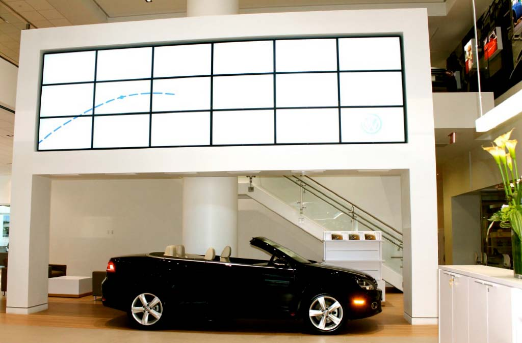 The finished Eleventh Avenue VW/Audi Manhattan reception lobby features massive product display fixtures built by J.T. Magen & Company Inc.